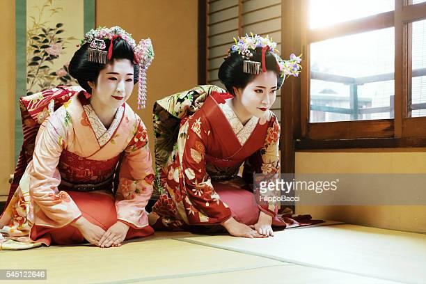 Young Maiko Praying Together