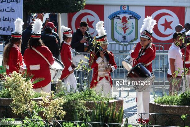Young Majorette girls taking part in the celebrations of the 9th anniversary of the revolution held on avenue Habib Bourguiba in the capital Tunis...