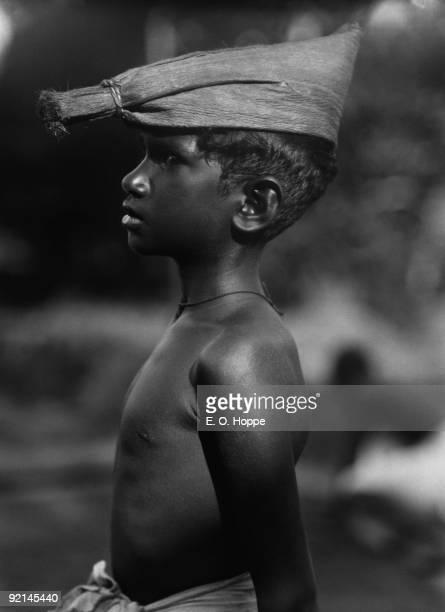 A young Malayali boy wearing a hat in Quilon or Kollam Kerala India 1929
