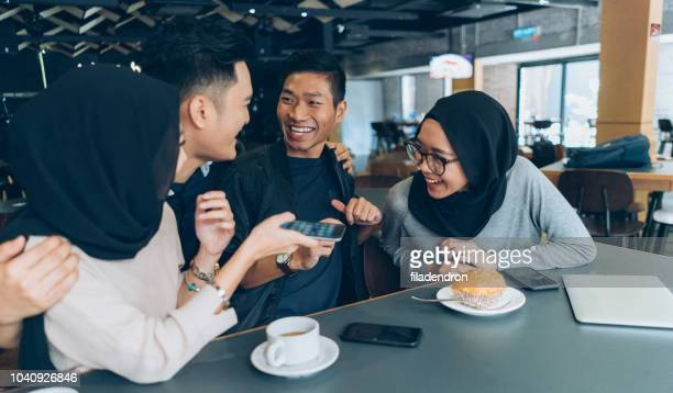 Young Malaysian couples in a cafe