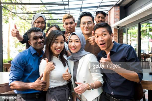 young malaysian friends - malaysian culture stock pictures, royalty-free photos & images