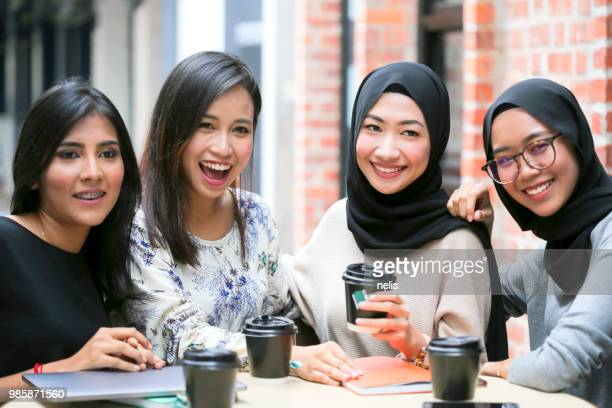 young malaysian girls - malaysian culture stock pictures, royalty-free photos & images