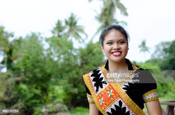 young malaysian woman in traditional cloth - malaysian culture stock pictures, royalty-free photos & images