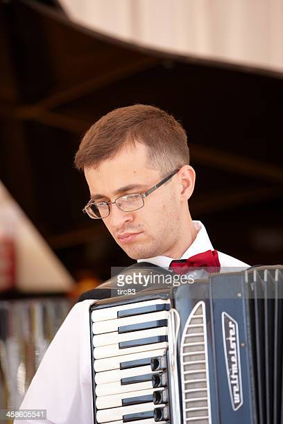 young male accordionist - accordionist stock pictures, royalty-free photos & images