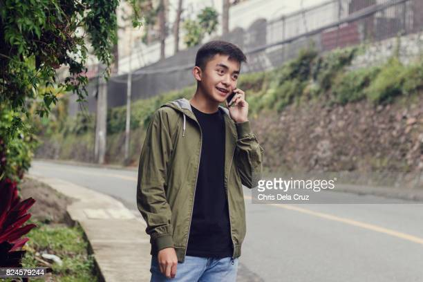 Young male adult calling on the street