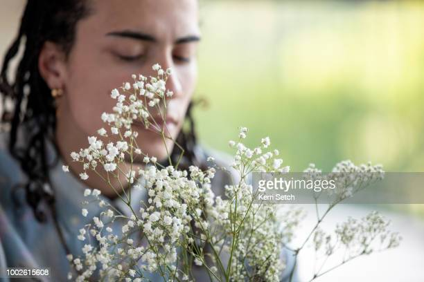 young male adult concentrating - botánica fotografías e imágenes de stock