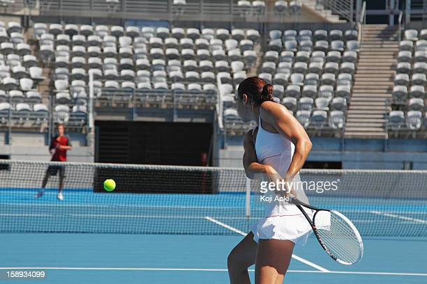 young male and female tennis players practicing - hardcourt stock photos and pictures