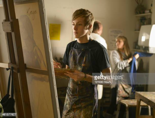 Young Male Art Student Painting