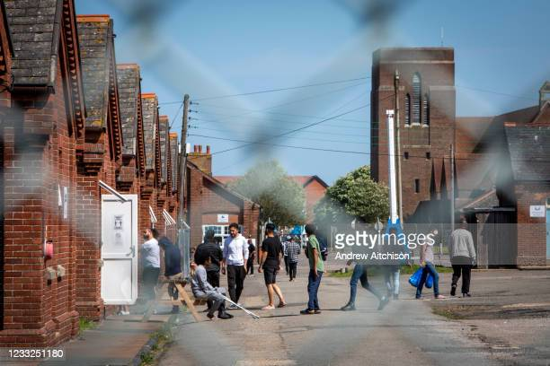 Young male asylum seekers hanging out inside Napier Barracks on the 3rd of June 2021, Folkestone, United Kingdom. Despite todays high court ruling...