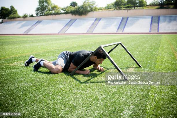Young male athelete training on track and field