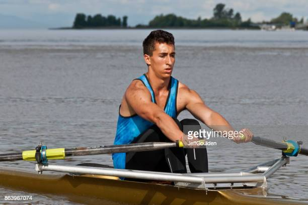 young man rowing a single scull on the fraser river - jeff goulden stock pictures, royalty-free photos & images