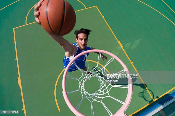 Young Male Basketball Player Making a Basket