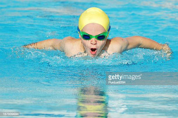 Young Male Boy Sports Athlete Butterfly Stroke Swimmer