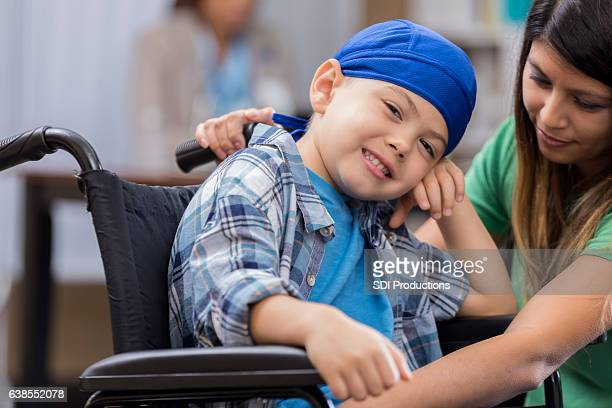 Young male cancer patient in hospital waiting room