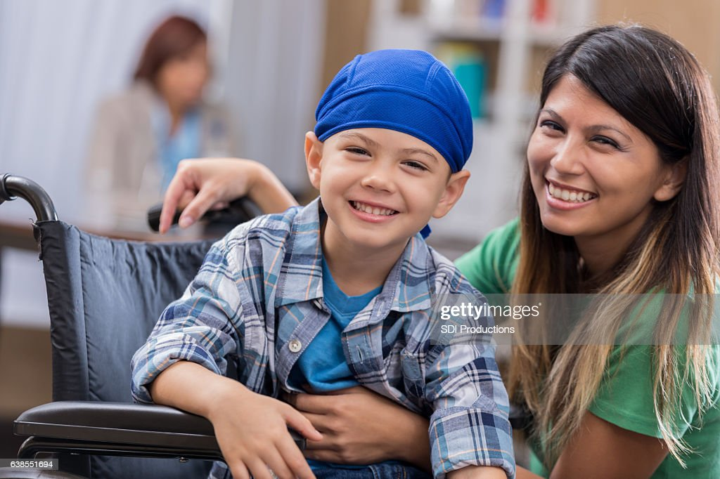 Young male cancer patient waits in waiting room : Stock Photo