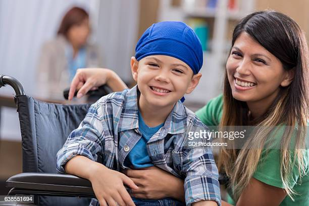 Young male cancer patient waits in waiting room
