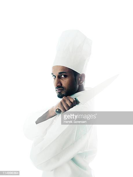 young male chef with knife