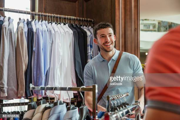 young male clothes shopping - menswear stock pictures, royalty-free photos & images