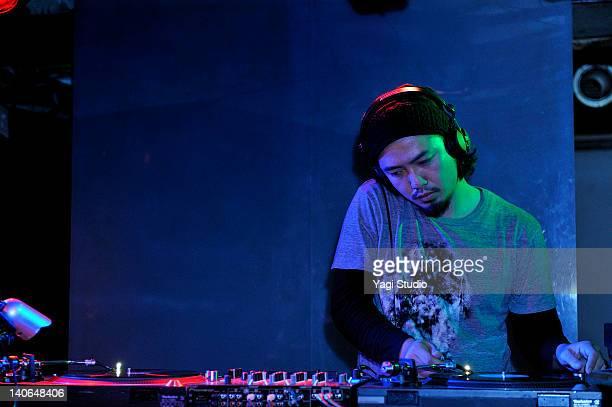 Young male DJ at record decks in nightclub,Japan