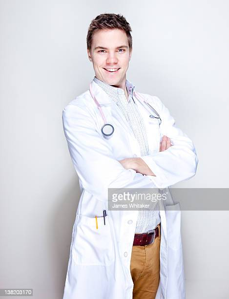 young male doctor - three quarter front view stock pictures, royalty-free photos & images