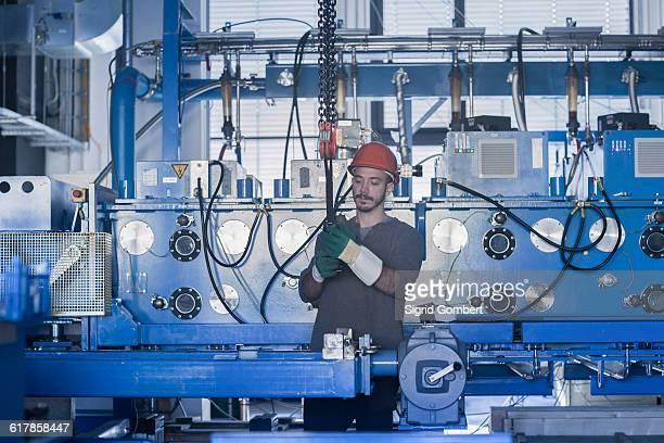 'Young male engineer working in an industrial plant, Freiburg im Breisgau, Baden-Württemberg, Germany'