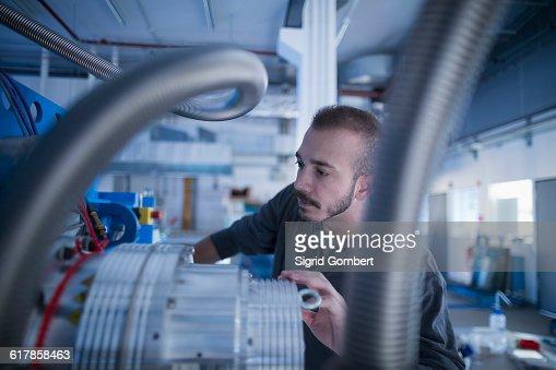 'Young male engineer working in an industrial plant, Freiburg im Breisgau, Baden-W��rttemberg, Germany'