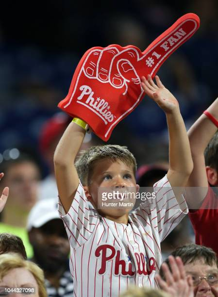 A young male fan of the Philadelphia Phillies cheers during a game against the Washington Nationals at Citizens Bank Park on August 27 2018 in...