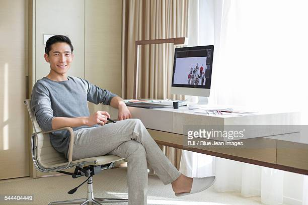 Young male fashion designer working at home