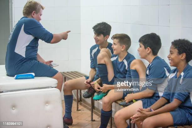 young male footballers having fun in locker room - young boys changing in locker room stock pictures, royalty-free photos & images