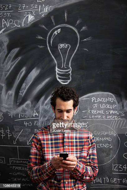 Young male getting an idea and sending message