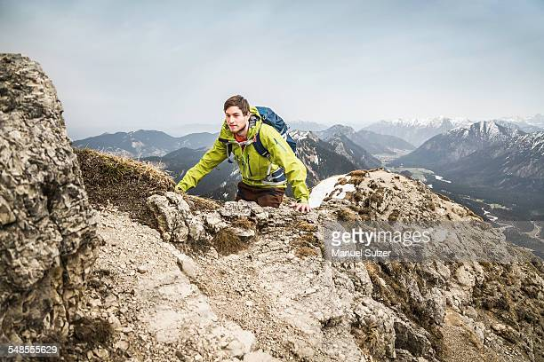 Young male hiker on Klammspitze mountain, Oberammergau, Bavaria, Germany