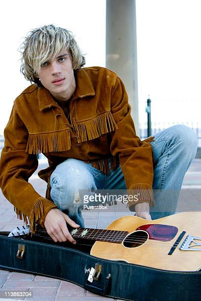 Young male hippie with guitar