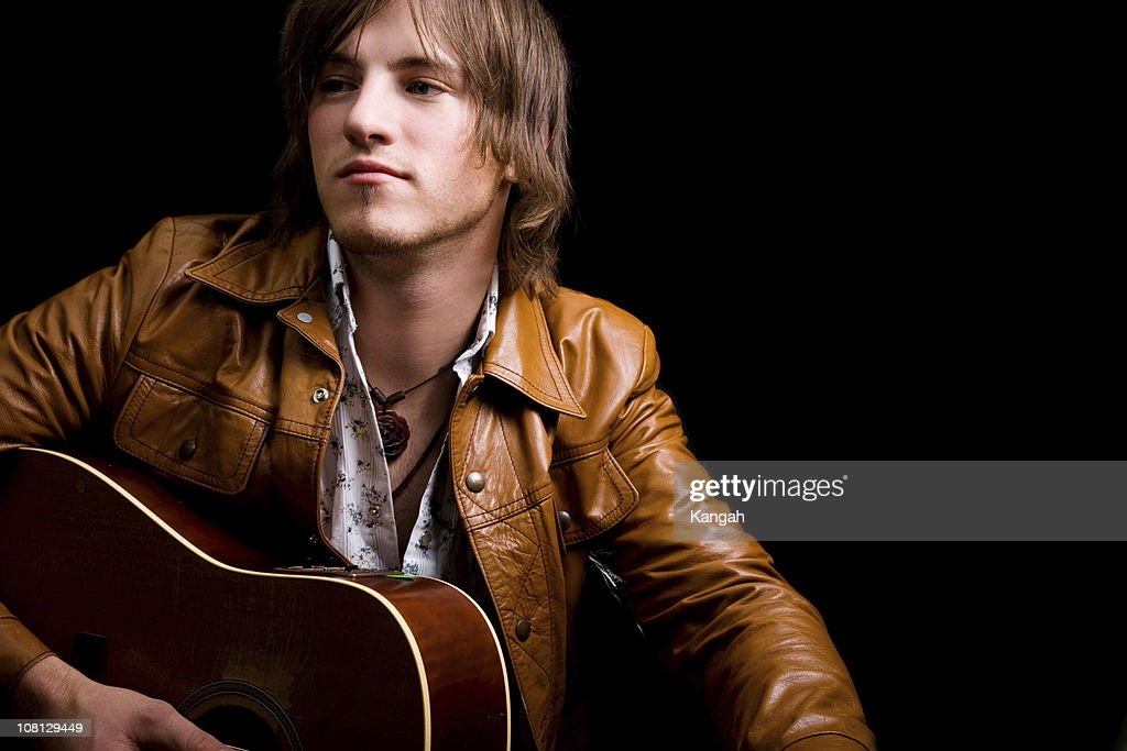 Young Male Holding Guitar : Stock Photo