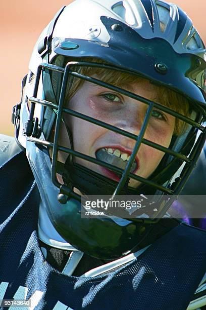 joven hombre reproductor de lacrosse sonrisas en la foto - gladiator fotografías e imágenes de stock