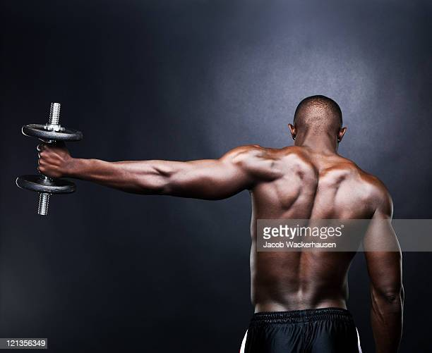 young, male lifting dumbbell - black male bodybuilders stock photos and pictures