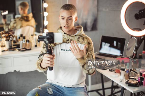 young male makeup artist - vlogging stock photos and pictures