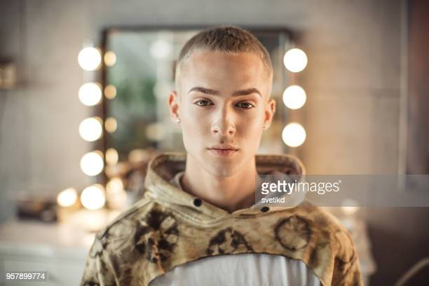 young male makeup artist - androgynous stock pictures, royalty-free photos & images