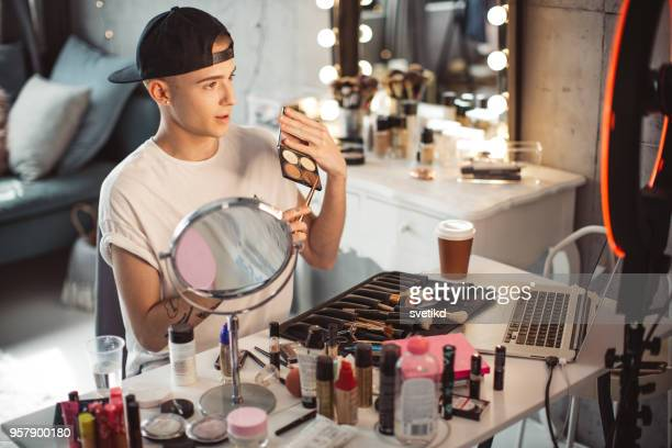 young male makeup artist - gender fluid stock photos and pictures