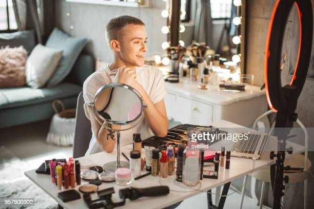 young male makeup artist - tutorial stock pictures, royalty-free photos & images
