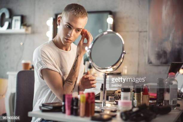 Young male makeup artist