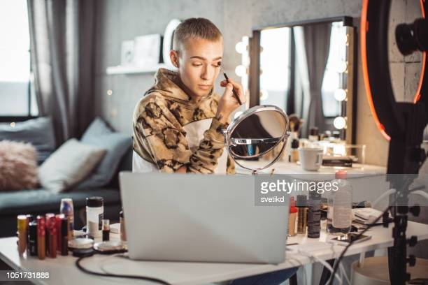 young male makeup artist vlogging at home - gender fluid stock pictures, royalty-free photos & images
