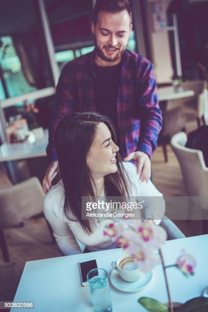 Young Male Massaging her Girlfriend while She Drink Morning Coffee