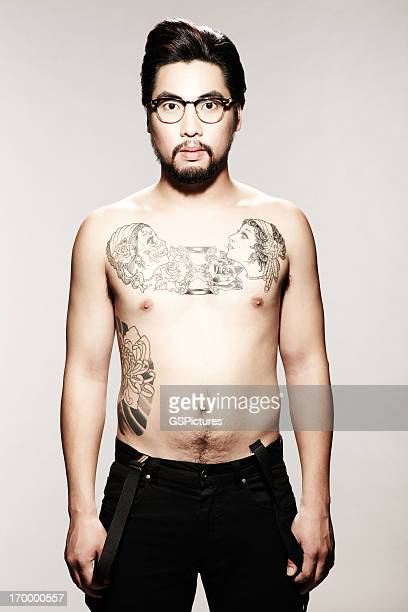 Young Male Model with Tattoo and Glasses