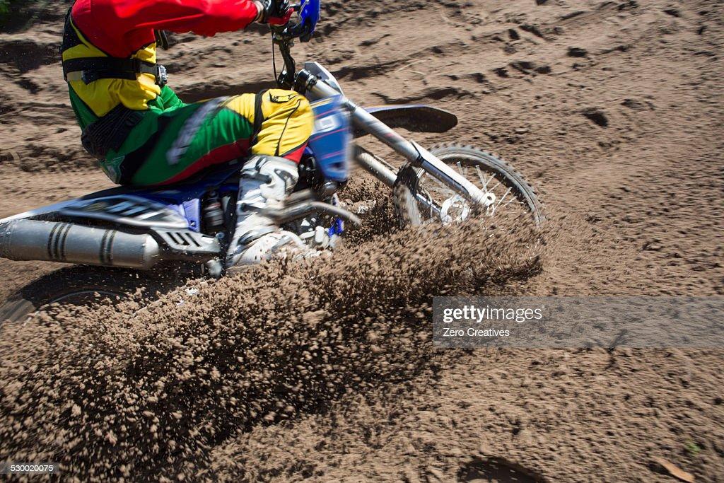 Motocross Rider Splashing Mud On Wet And Muddy Terrain