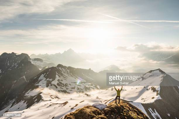 young male mountain trekker with arms raised in bavarian alps, oberstdorf, bavaria, germany - upper bavaria stock photos and pictures