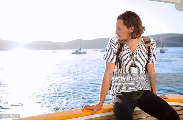 Young male on Sydney Pittwater ferry with sun flare