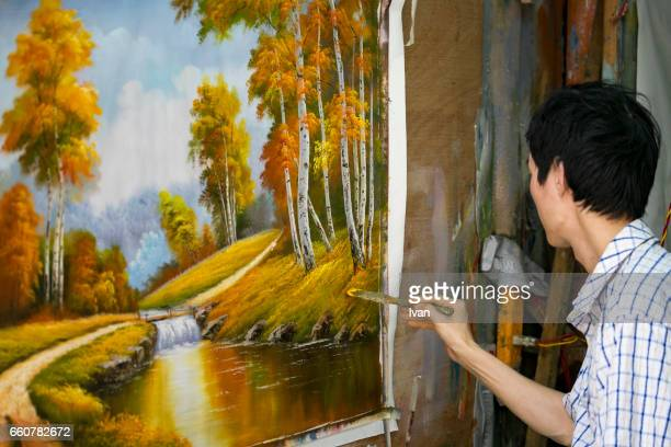 A Young Male Painter Drawing a Landscape Oil Painting