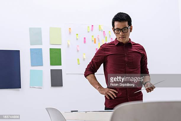 Young male preparing work in design studio