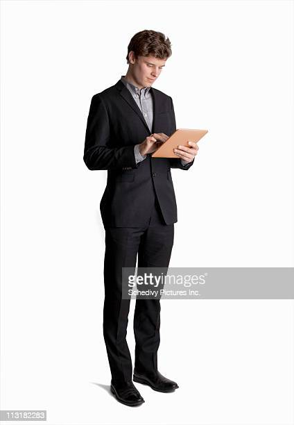 Young male professional (25-35) using a tablet pc