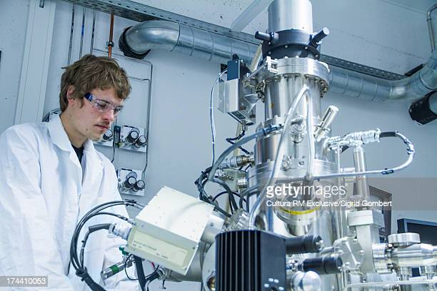 Young male scientist at work